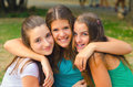 Happy teenage girls having fun outdoor three in the park Stock Photography