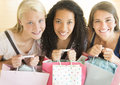 Happy teenage girls with shopping bags high angle portrait of Stock Photography