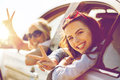 Happy teenage girls or women in car at seaside Royalty Free Stock Photo