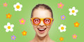 Happy teenage hippy girl in shades with peace sign people summer accessories and pop art concept screaming over green background Stock Images