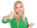 Happy teenage student girl showing thumbs up Royalty Free Stock Photo