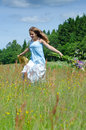 Happy teenager run through the summer field brunette portrait in Stock Image