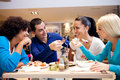 Happy teenagers having lunch fun while at restaurant Royalty Free Stock Images