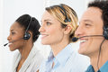 Happy telephone operators businesspeople wearing headsets working in call center Royalty Free Stock Images