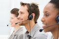 Happy telephone operators closeup of in a row Stock Photo