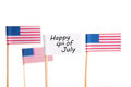 Happy th of july a white flag with and some american flags in the background isolated Stock Image