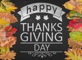 Happy Thanks giving day design quote on blackboard with autumn Royalty Free Stock Photo