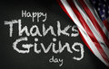 Happy Thanks Giving Day written on blackboard and the USA flag Royalty Free Stock Photo