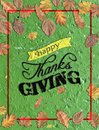 Happy thanks giving written on green concrete with several leaves