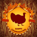 Happy Thanksgiving day. Vintage hand drawn vector illustration with turkey and autumn leaves on wooden background.