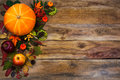 Happy Thanksgiving decor with fall leaves on wooden background