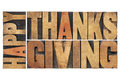 Happy thanksgiving greetings or wishes isolated word abstract in vintage letterpress wood type blocks Royalty Free Stock Image