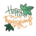 Happy Thanksgiving hand lettering decorated with pumpkin leaves