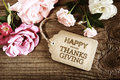 Happy Thanksgiving message card with small roses Royalty Free Stock Photo