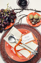 Happy thanksgiving orange polka dots dinner table setting aerial lunch brunch or casual modern dining shabby chic with autumn fall Royalty Free Stock Photo