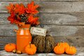 Happy Thanksgiving tag with autumn decor against wood Royalty Free Stock Photo