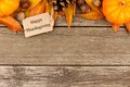 Happy Thanksgiving tag with autumn top border on rustic wood