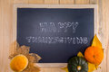 Happy thanksgiving word cloud on a vintage slate blackboard autumn fruit for autumn nature fall fruit wood Royalty Free Stock Photo