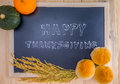 Happy thanksgiving word cloud on a vintage slate blackboard autumn fruit for autumn nature fall fruit wood Stock Photography