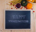 Happy thanksgiving word cloud on a vintage slate blackboard autumn fruit for autumn nature fall fruit wood Royalty Free Stock Images
