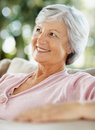 Happy thought - Happy senior relaxed female Royalty Free Stock Photo