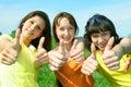 Happy three friend show sign ok Stock Photo