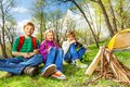 Happy three friends rest together during camping Royalty Free Stock Photo