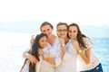 Happy three generation family on a summer seashore vacation group portrait smiling of grandmother mother daughter beach sunny day Royalty Free Stock Photography