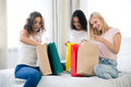 Happy three girls with many shopping bags Royalty Free Stock Photo
