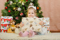 Happy three year old girl with a big Christmas gift Royalty Free Stock Photo