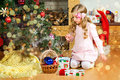 Happy toddler girl celebrate Christmas and New Year