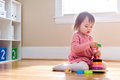 Happy toddler girl playing with her toys Royalty Free Stock Photo