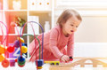 Happy toddler girl playing with toys Royalty Free Stock Photo