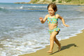 Happy toddler girl running at beach Stock Photography