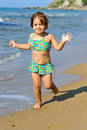 Happy toddler girl running on beach Royalty Free Stock Photography