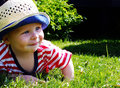 Happy toddler in the grass Royalty Free Stock Photography