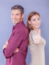 Happy togetherness successful couple with thumb up Royalty Free Stock Image