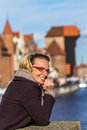 Happy tourist on the background of the old town of gdansk poland Royalty Free Stock Image