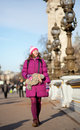 Happy tourist girl with funny bag in Paris Stock Images