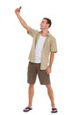 Happy tourist making photos of himself Royalty Free Stock Image