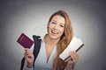 Happy tourist young woman holding passport holiday flight ticket