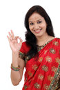 Happy traditional indian woman making ok gesture against white Royalty Free Stock Photos
