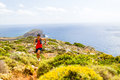 Happy trail running man in inspirational mountains Royalty Free Stock Photo