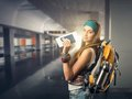 Happy traveler woman is waiting for a flight Royalty Free Stock Photo