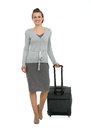 Happy traveling woman with suitcase making step fo Stock Images