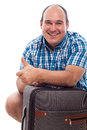 Happy traveller man with luggage Stock Image