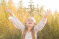 Happy triumphant girl in autumn park at dusk with strong backlight Royalty Free Stock Images