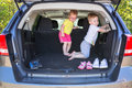 Happy twins playing in the car Royalty Free Stock Photo