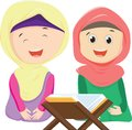 Happy two Muslim girls reading Quran together