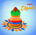 Happy Ugadi and Gudi Padwa Hindu New Year. Greeting card for holiday. Colored pot with coconut on beautiful light blue blurred bac